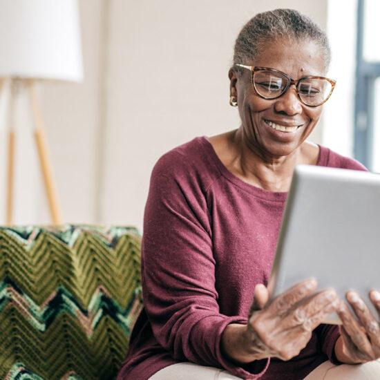 woman looking at ipad