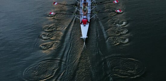 A rowing boat with rowers in it