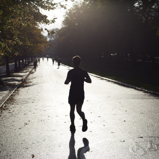 Silhouetted man runnng