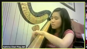 Asian woman playing harp