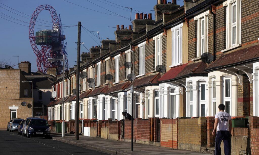 A residential street in Newham with the ArcelorMittal Orbit in the background.