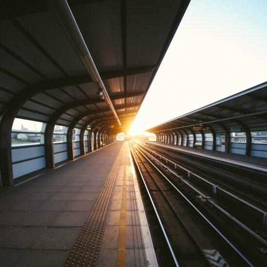 Empty train platofrm with sun rising in the horizon